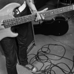 hands and guitar in rehearsal space